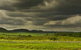 Картинка дорога, гроза, поле, холмы, серые облака
