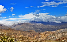 Обои скалы, горы, цветы, облака, небо