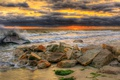 Картинка море, волны, небо, тучи, камни, берег, зарево