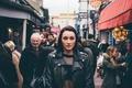 Картинка девушка, город, люди, волосы, куртка, губы, прямой взгляд