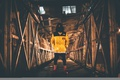Картинка свет, мост, завод, человек, капот, ангар, тени