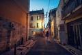 Картинка улицы, дома, город, сумерки, девушка, фонарные столбы, знаки