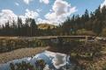 Картинка облака, река, небо, ручей, мужчина, зеркало, коряги