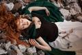 Картинка девушка, камни, перья, плащ, рыжеволосая