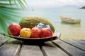 Картинка море, облака, цветы, лодка, яблоки, кокос, фрукты