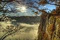 Картинка облака, ветки, скалы, деревья, солнце, небо