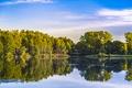 Картинка небо, облака, деревья, озеро, отражение, зеркало, мужчина
